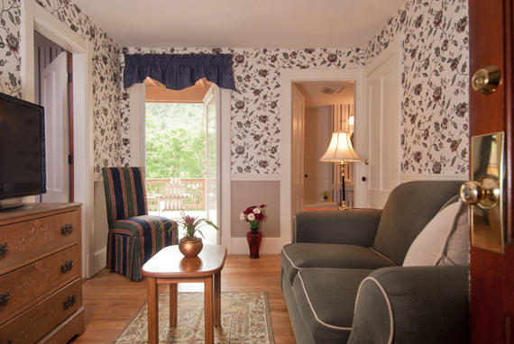 Paradise Falls sitting room with loveseat and chair
